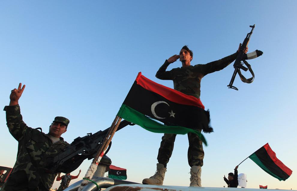 Ливийские повстанцы шантажируют власть,  а сирийские расстреливают христиан.